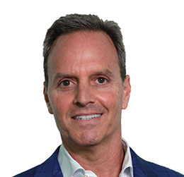 Headshot of Executive Vice President and President, North America - Glen Walter