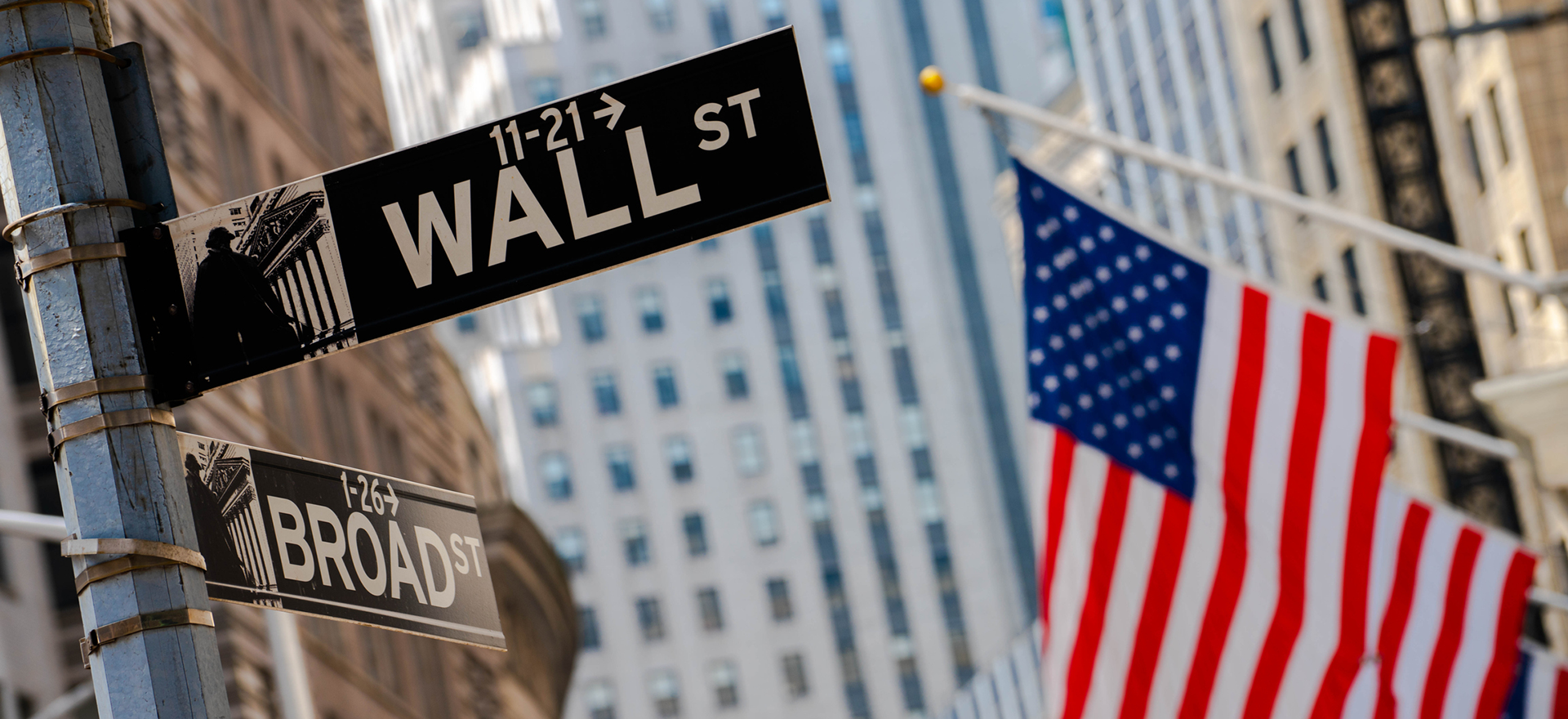 Wall Street sign and American Flag