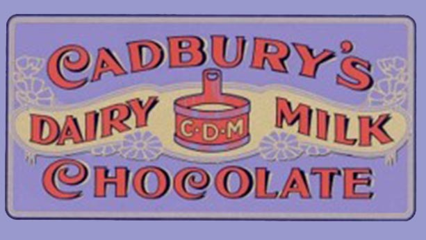 "Vintage label from 1905 of written script that says ""Cadbury's dairy milk chocolate"""