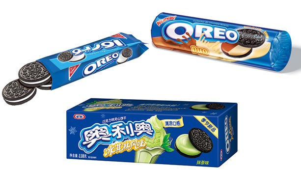 Multiple Oreo packages from different countries. One in Chinese with a green tea flavour. One with a mocha flavour.