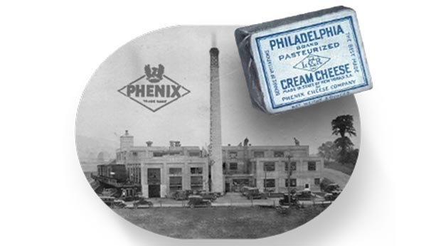 Picture from 1903 of Phenix cheese factory with a Philadelphia cream cheese pack in the foreground also from that time.