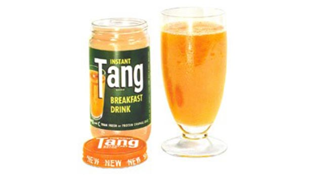 Tang jar from 1957 with a glass full of tang next to it.