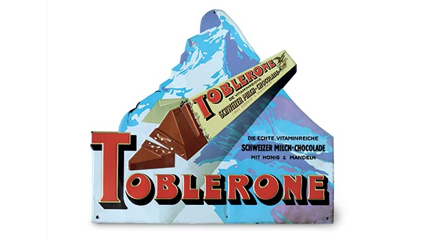 1970s ad of Toblerone package opened with the backdrop of matterhorn mountain in the background.